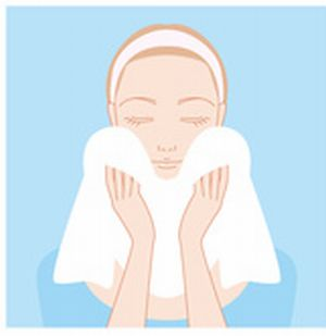 洗顔のすすぎ後に、タオルで顔についた水分を拭き取るイラスト